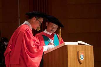 Dr Jack MA signs the Register of the Honorary Degree Graduates